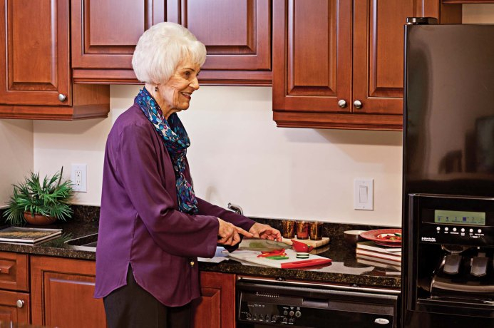 Granite counter tops and custom kitchen cabinetry are standard in all kitchens.