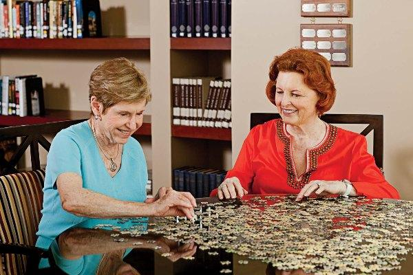 In the Library, puzzles and games bring residents together.