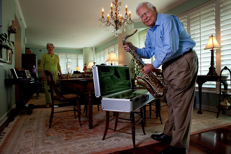 A Lenbrook resident puts away his saxophone after entertaining fellow residents.